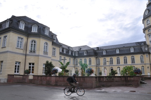 guy riding a bike at the Schloss Karlsruhe
