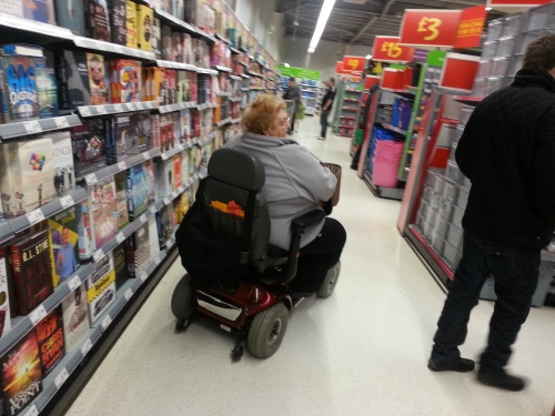 Fat person on a mobility scooter at a Wal-Mart in England