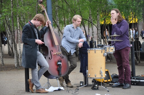 Apparently, the bass player in this little troupe of street entertainers can't even entertain himself...